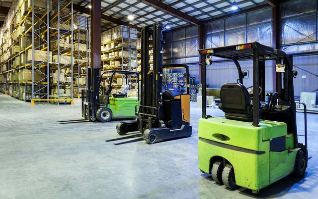 24153723 - large modern warehouse with forklifts