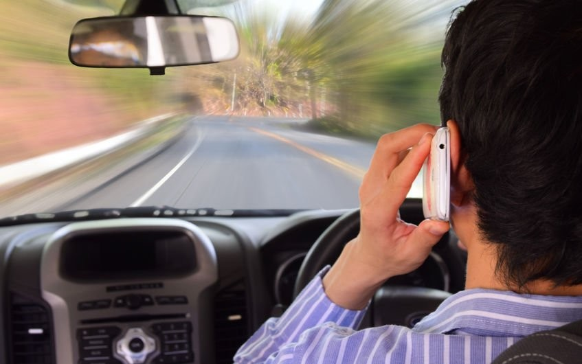 driving while holding a mobile phone