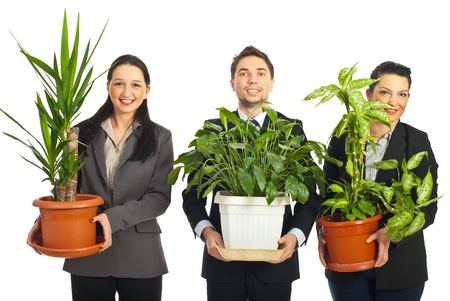 8616861 - happy business people holding big vases with plants and standing in a row  isolated on white background