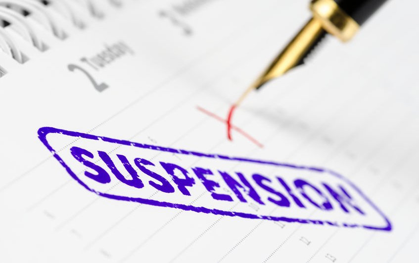 how to suspend an employee on full pay