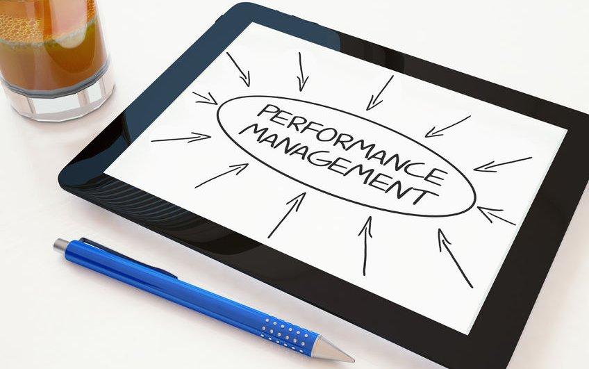 46009805 - performance management - text concept on a mobile tablet computer on a desk - 3d render illustration.