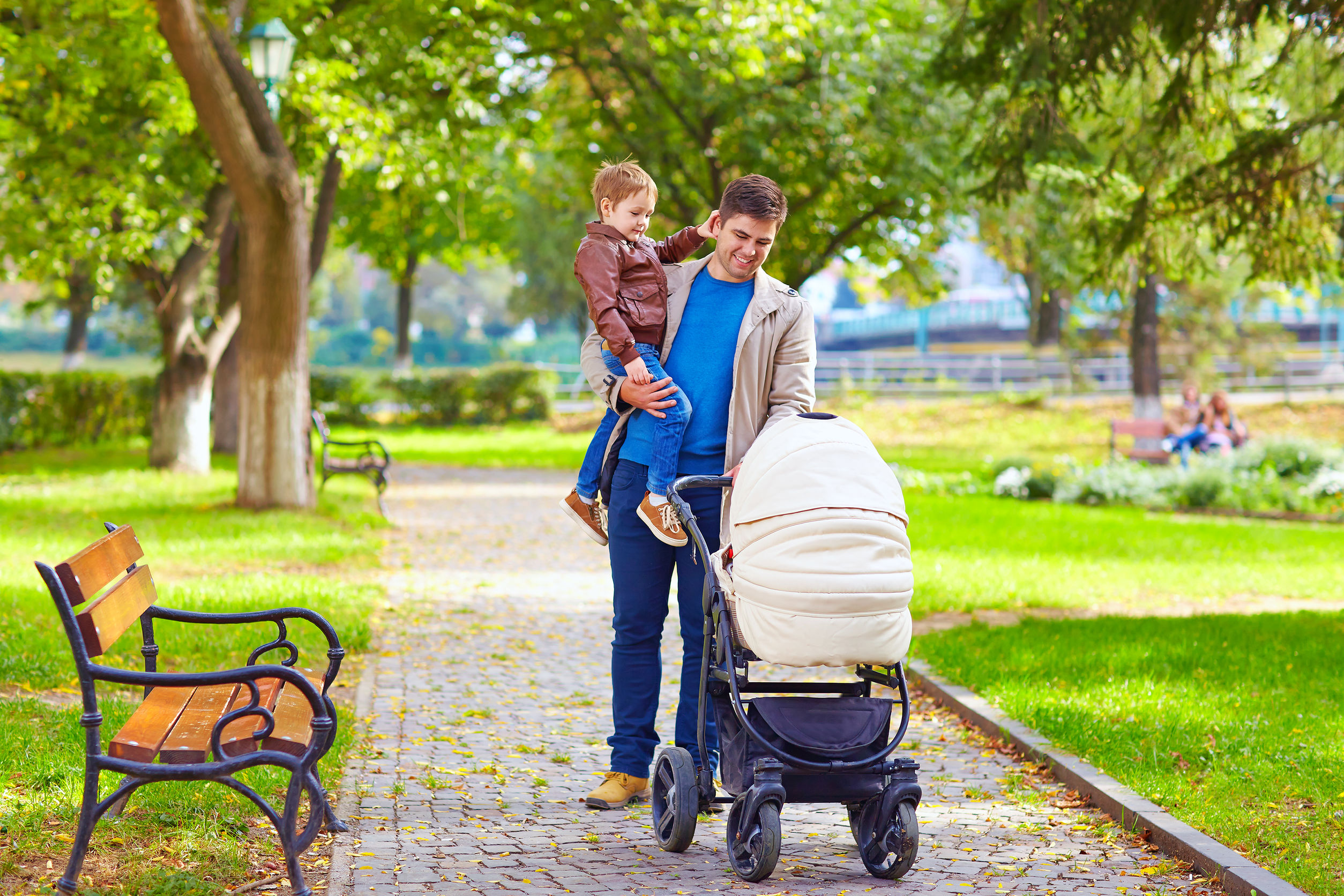 32371539 - father with kids walking in city park