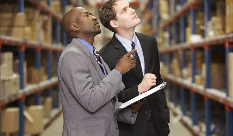 19530926 - two businessmen having discussion in warehouse